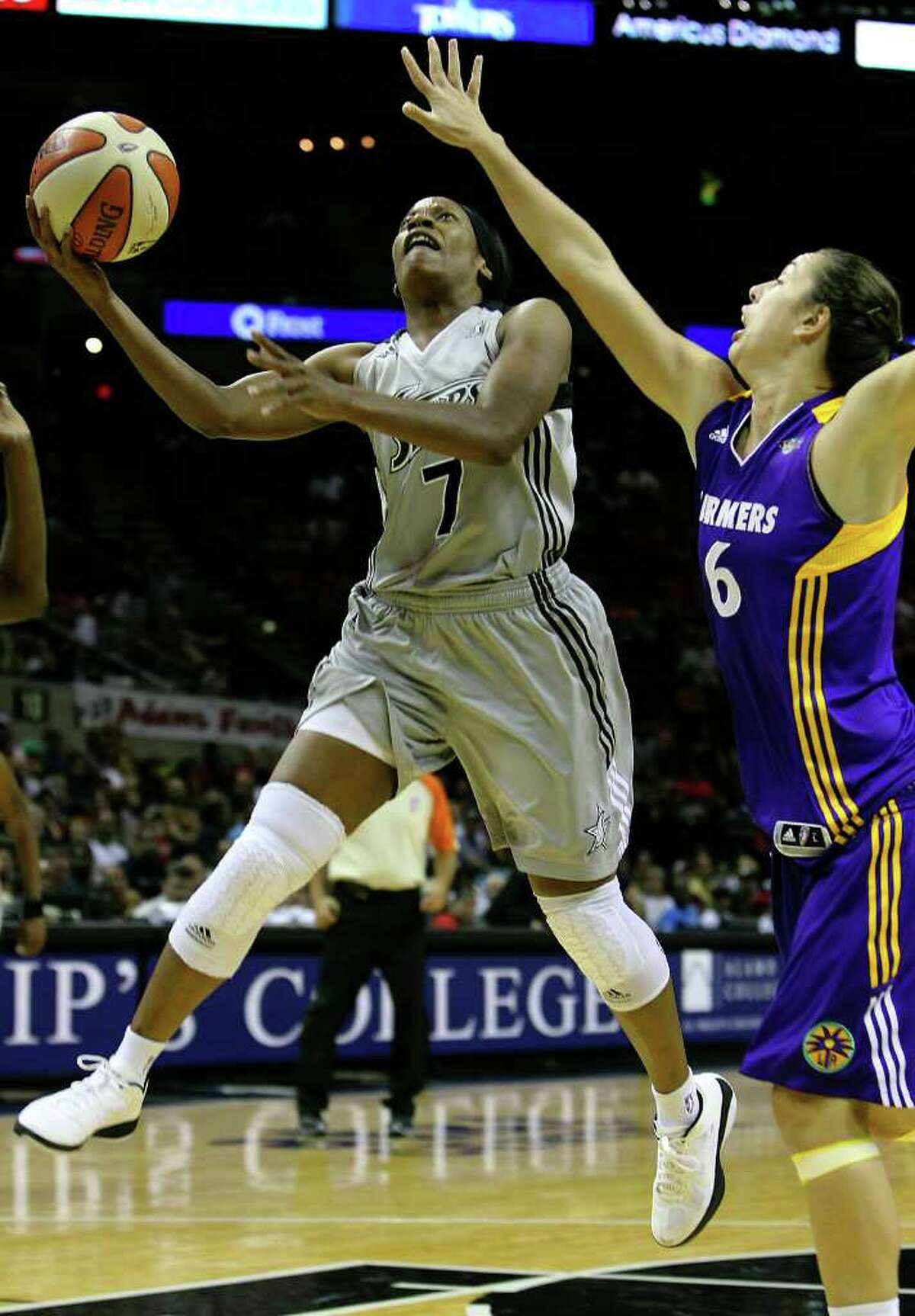 Silver Stars' Jia Perkins (07) goes for score against Los Angeles Sparks' Jenna O'Hea (06) in the first half at the AT&T Center on Friday, June 24, 2011. Kin Man Hui/kmhui@express-news.net