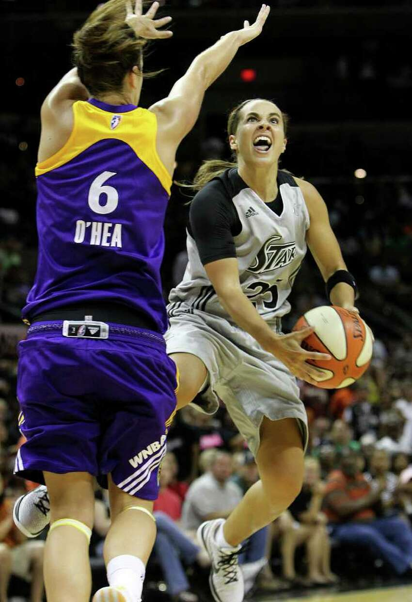 Silver Stars' Becky Hammon (right) goes to the basket against Los Angeles Sparks' Jenna O'Hea (06) in the second half at the AT&T Center on Friday, June 24, 2011. Hammon scored 22 points as the Silver Stars defeated the Sparks, 90-80, in overtime. Kin Man Hui/kmhui@express-news.net