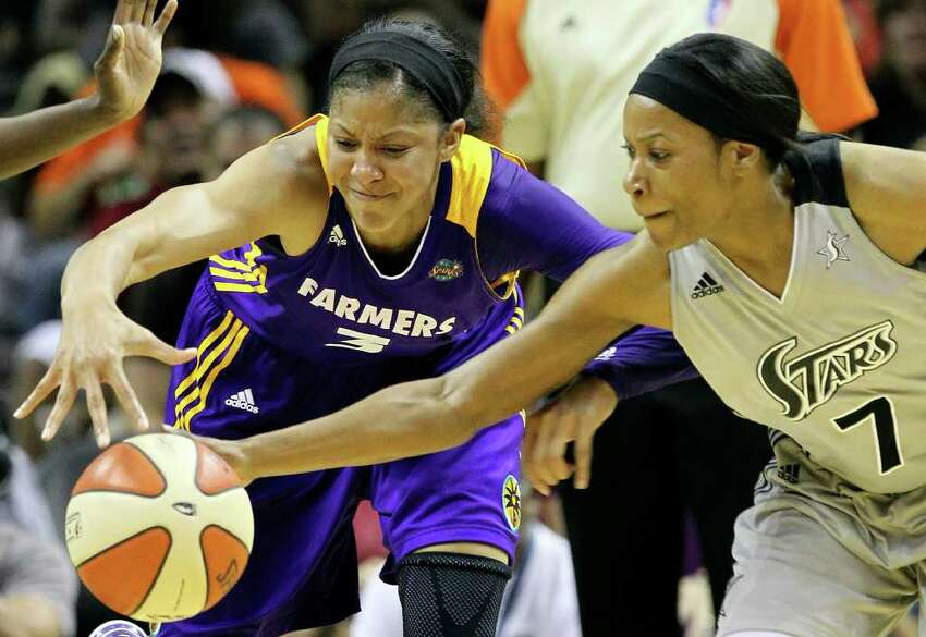 Silver Stars' Jia Perkins (07) steals the ball from Los Angeles Sparks' Candace Parker (03) in the second half at the AT&T Center on Friday, June 24, 2011. Silver Stars defeated the Sparks, 90-80, in overtime. Kin Man Hui/kmhui@express-news.net