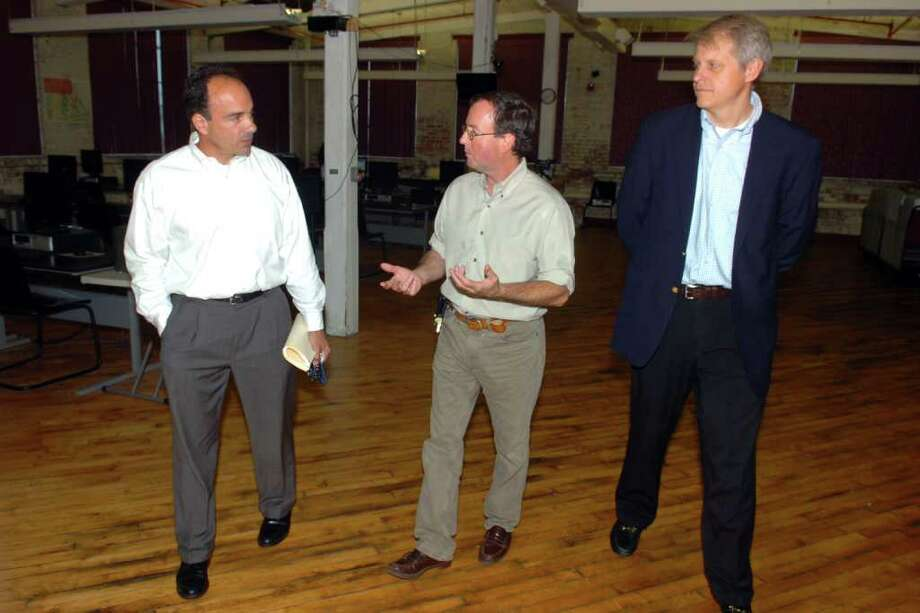 Former Bridgeport Mayor Joseph Ganim talks with Executive Director George Stowell and Vice Chairman John Bisack during a tour of BAYM (Bridgeport Area Youth Ministry), in Bridgeport, Conn. June 23rd, 2011. Photo: Ned Gerard / Connecticut Post