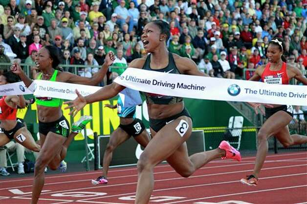 Carmelita Jeter (3), center, wins the 100-meter dash while Marshevet Myers, left, and Alexandria Anderson, right, also compete at the U.S. outdoor track and field championships in Eugene, Ore., Friday, June 24, 2011. (AP Photo/Rick Bowmer) Photo: Rick Bowmer, Associated Press / AP
