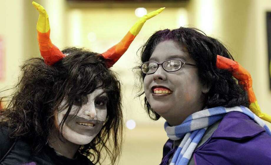 Rebecca Onofre, 15, as Gamzee Makara, (left) and Kathleen Hinojosa, 15, as Eridan Ampora, poses for a photo. Photo: Edward A. Ornelas/Express-News / © SAN ANTONIO EXPRESS-NEWS (NFS)