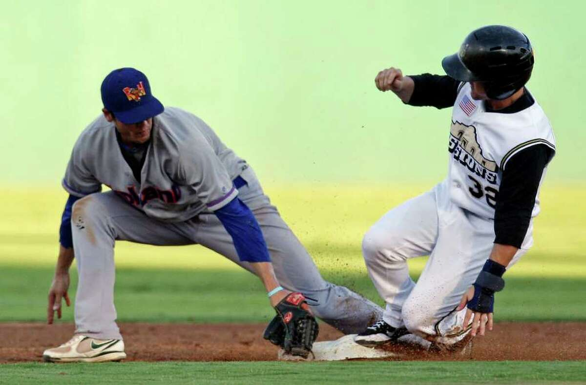 Missions' Daniel Robertson steals second base ahead of the tag from Rockhounds' Grant Green during the third inning.