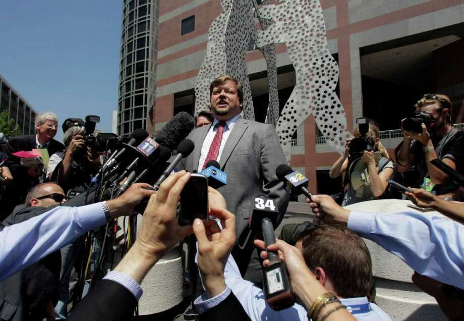 "Assistant U.S. Attorney Robert Dugdale, center, talks to reporters after an arraignment of fugitive crime boss James ""Whitey"" Bulger outside the Roybal Federal Building in Los Angeles, Thursday, June 23, 2011. The Boston mob boss has appeared in Los Angeles federal court and been remanded to Massachusetts to face charges. (AP Photo/Jae C. Hong) Photo: Jae C. Hong"