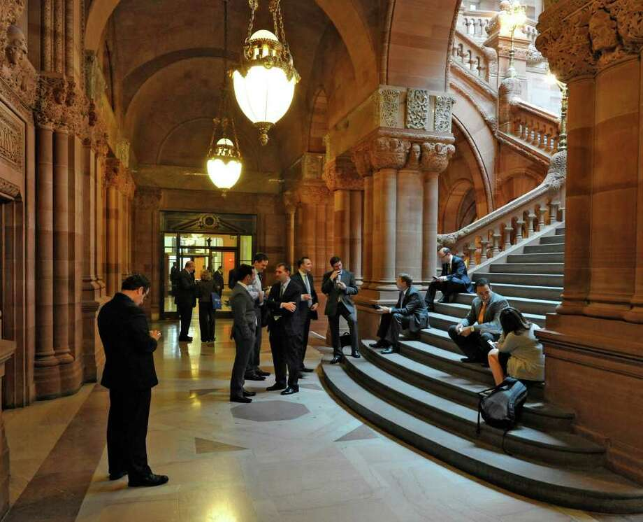Lobbyists gather near the Million Dollar Staircase as closed door sessions by the Republicans continue to try to resolve the numerous bills that are under consideration at the Capitol in Albany, N.Y. June 24, 2011.    (Skip Dickstein / Times Union) Photo: SKIP DICKSTEIN / 2011