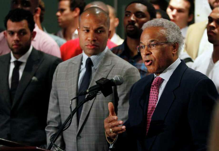 National Basketball Players Association union president Derek Fisher, of the Los Angles Lakers, listens as NBPA executive director Billy Hunter, right, speaks during a news conference, Thursday, June 23, 2011, with NBA players standing behind them in New York. The NBA's collective bargaining agreement expires June 30 and the sides remain far apart. Fisher said players won't accept a bad deal to avoid a work stoppage. (AP Photo/Bebeto Matthews) Photo: Bebeto Matthews