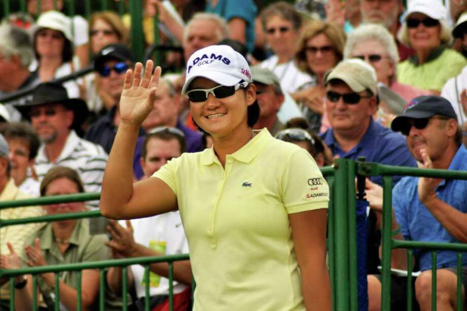 Yani Tseng, of Taiwan, waves to the crowd as she is introduced before teeing-off for the second round of the Wegmans LPGA Championship golf tournament in Pittsford, N.Y., Friday, June 24, 2011. (AP Photo/Heather Ainsworth) Photo: Heather Ainsworth