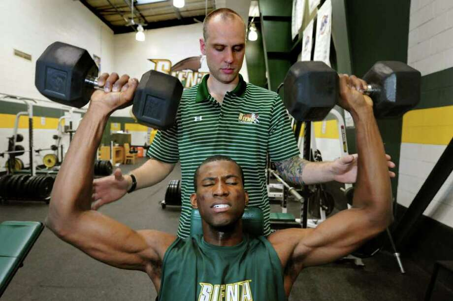 Siena basketball freshman Imoh Silas of Nigeria works with strength coach Dan Taylor on Friday, June 24, 2011, at Siena College in Loudenville, N.Y. (Cindy Schultz / Times Union) Photo: Cindy Schultz