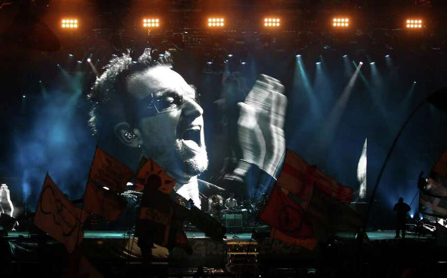 Bono of U2 performs on the Pyramid Stage at the Glastonbury Festival site at Worthy Farm, Pilton in Glastonbury, England, on Friday, June 24, 2011. Music fans had to brave more rain Friday at the five-day festival, which opened on Wednesday. This year's festival features headline acts U2, Coldplay and Beyonce. The festival, which started in 1970 when several hundred hippies paid 1 British pound to watch Marc Bolan, has grown into Europe's largest music festival, attracting more than 175,000 people. Photo: Matt Cardy, Getty Images / 2011 Getty Images