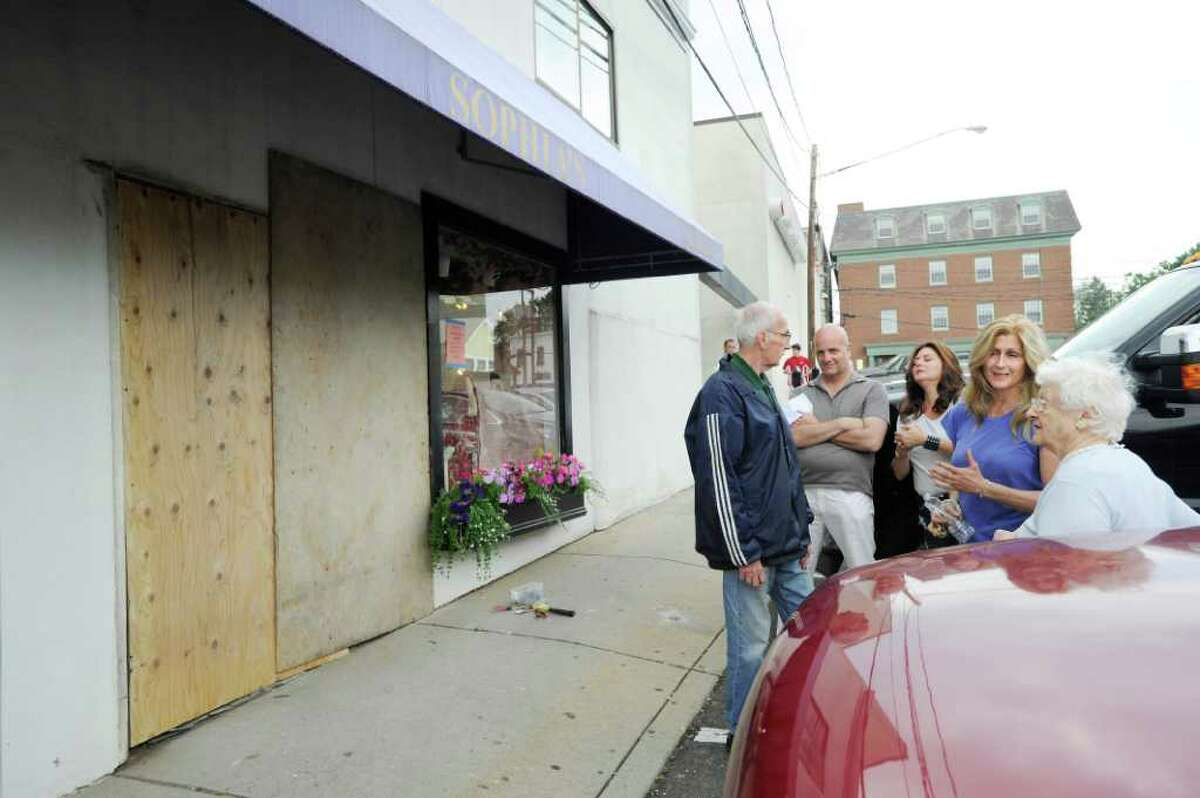 Sophia Scarpelli, second from right, owner of Sophia's Costumes, at 1 Liberty Way in downtown Greenwich, during the aftermath of an accident in which a car drove through the front of her store around 11:30 a.m. Saturday June 25, 2011. No one was injured, but Scarpelli said she will be closed for a week to repair the damage caused to the front door, wall and interior of the store. The man, who was driving an older Buick Century with New York state license plates, was described as elderly by witnesses. His name was not available from police.