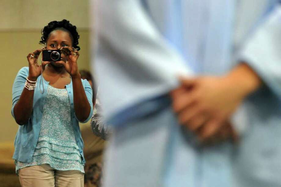 Kesherise Mills gets her camera ready to photograph her sister Ge'Net Ninstant during Columbia High commencement exercises on Saturday, June 25, 2011, at Hudson Valley Community College in Troy, N.Y. (Cindy Schultz / Times Union) Photo: Cindy Schultz