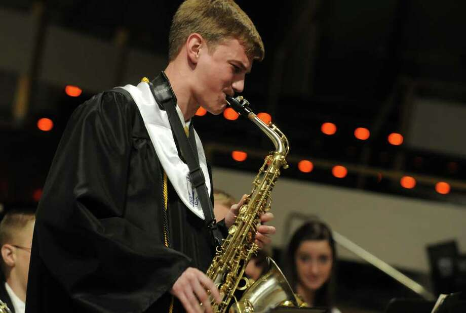 Class Salutatorian Andrew Lammly plats a sax solo with schools jazz ensemble during the Ravena-Coeymans-Selkirk Senior High School fifty-fifth annual comencement ceremony at the Empire Stae Plaza in  Albany, NY Saturday June 25, 2011. ( Michael P. Farrell/Times Union ) Photo: Michael P. Farrell