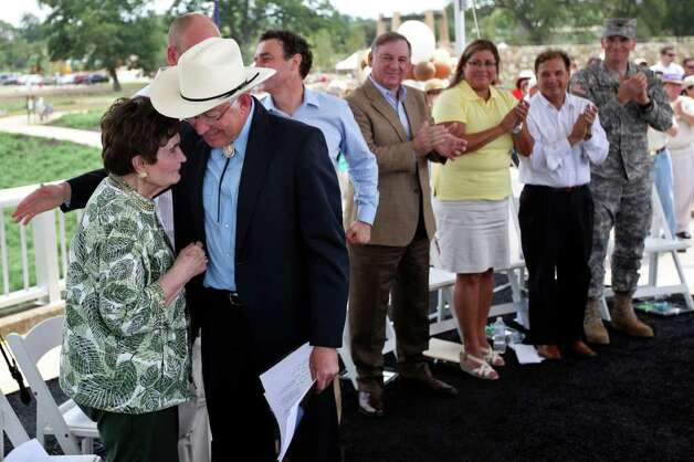 United States Secretary of the Interior Ken Salazar, right, gives Lila Cockrell, President of the San Antonio Parks Foundation, a hug after giving his speech at the grand opening celebration of phase 1 and 2 of Mission Reach on June 25, 2011, on the Theo Avenue Bridge. With the opening of the second mile, walkers and bikers can now connect to Mission Concepcion, part of a plan to connect all four missions to the river. Photo: ANDREW BUCKLEY, Andrew Buckley/Express-News / abuckley@express-news.net