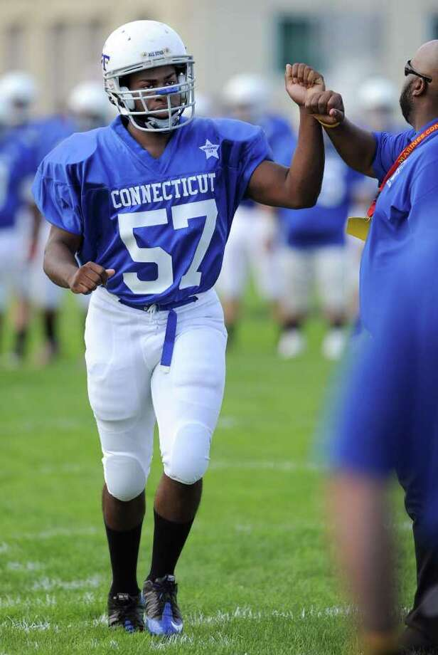 Stamford High School's Mark Robinson enters the field for the Connecticut High School football all-star game against Rhode Island on June 25, 2011, at Southington High School. Photo: Lindsay Niegelberg / Connecticut Post