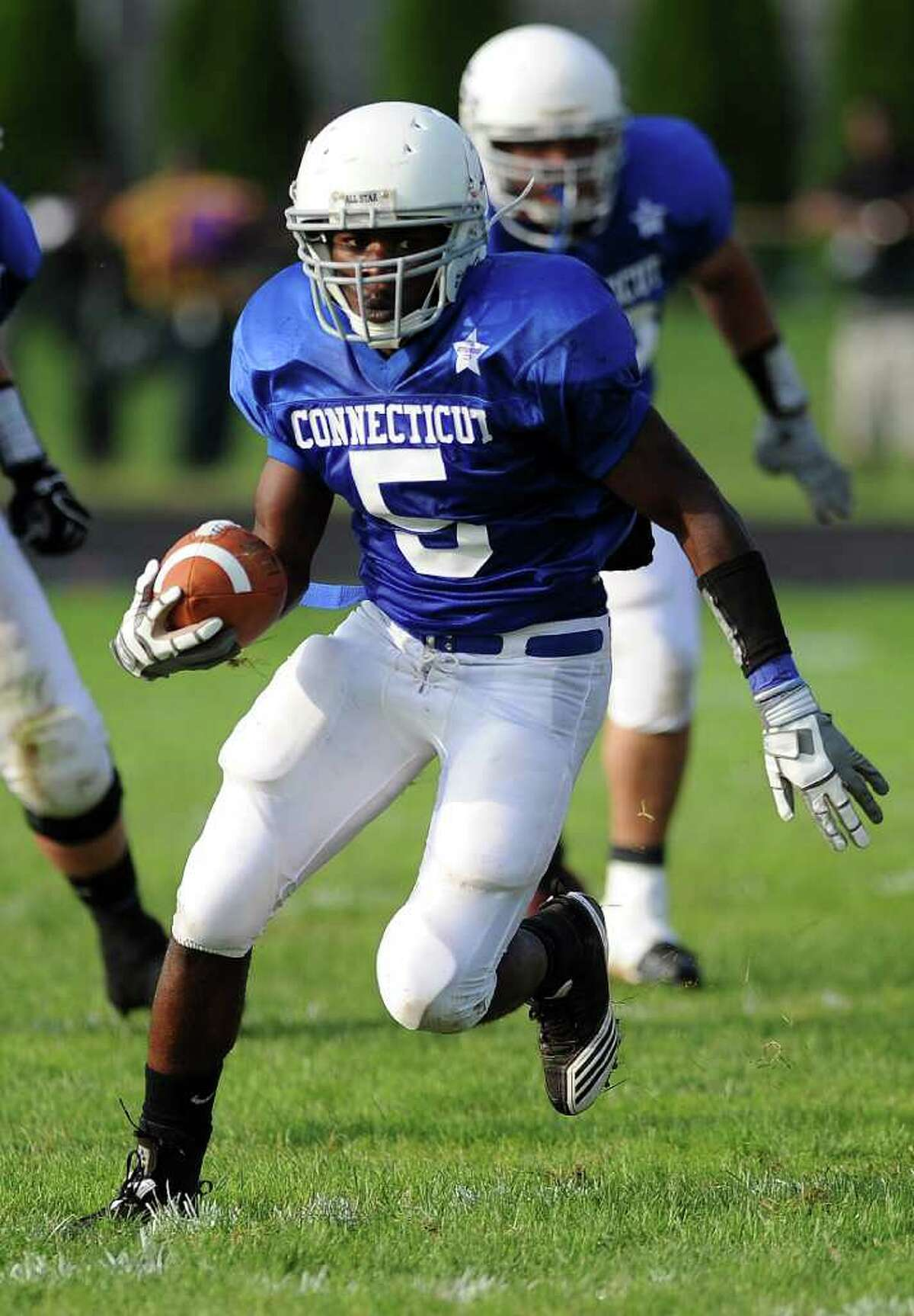 Ansonia High School's Montrell Dobbs carries the ball during the Connecticut High School football all-star game against Rhode Island on June 25, 2011, at Southington High School.
