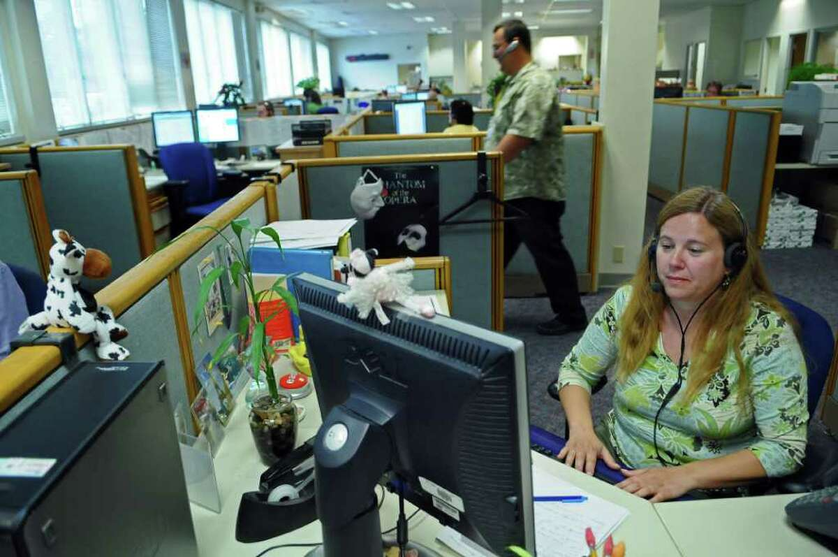 Utility Consumer Assistance Specialist Sharon Alvaro works with fellow employees fielding phone calls at the New York State Public Service Commission call center on Thursday June 23, 2011 in Delmar, NY. ( Philip Kamrass / Times Union)