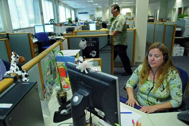 Utility Consumer Assistance Specialist Sharon Alvaro works with fellow employees fielding phone calls at the New York State Public Service Commission call center on Thursday June 23, 2011 in Delmar, NY.  ( Philip Kamrass / Times Union) Photo: Philip Kamrass