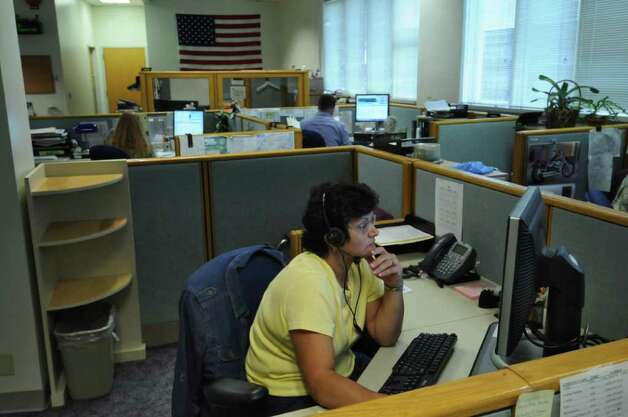 Utility Consumer Assistance Specialist Susie Baker works with fellow employees fielding phone calls at the New York State Public Service Commission call center on Thursday June 23, 2011 in Delmar, NY.  ( Philip Kamrass / Times Union) Photo: Philip Kamrass