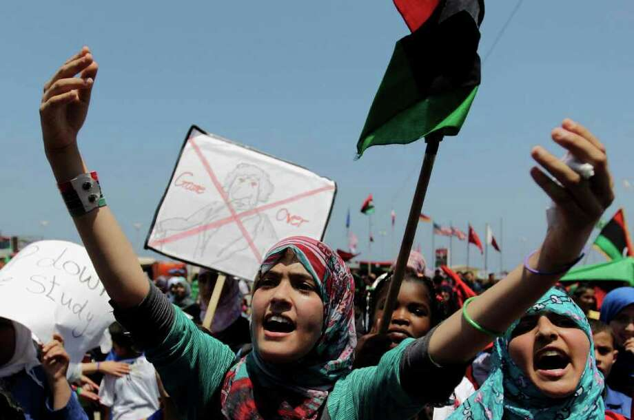 School students chant slogans against Moammar Gadhafi at the court square in the rebel-held capital Benghazi, Libya, Saturday, June 25, 2011. (AP Photo/Hassan Ammar) Photo: Hassan Ammar / AP