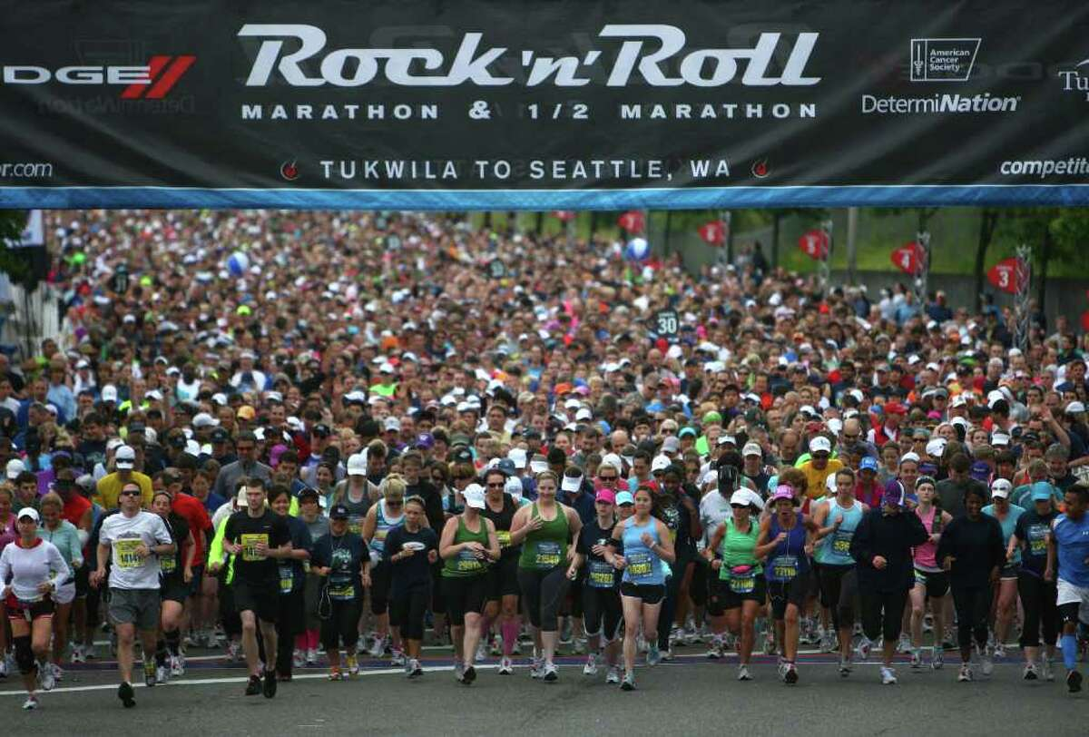Runners begin the Dodge Rock 'n' Roll Seattle Marathon & Half Marathon in Tukwila on Saturday, June 25, 2011. 26,000 runners -and some walkers- participated in the event. Competitor Jonathan Ndambuki of Kenya won the men's marathon with a time of 2:24:51. Sheila Croft of Redmond won the women's marathon with a time of 2:50:21. Carlos Trujillo of Idaho won the men's half with a time of 1:03:51. Mattie Suver of Seattle won the women's half with a time of 1:15:40.