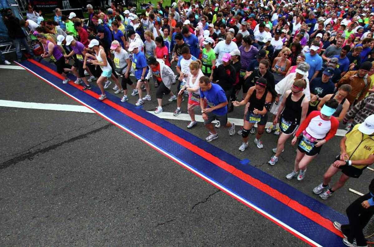 Runners begin the Dodge Rock 'n' Roll Seattle Marathon & Half Marathon in Tukwila on Saturday.