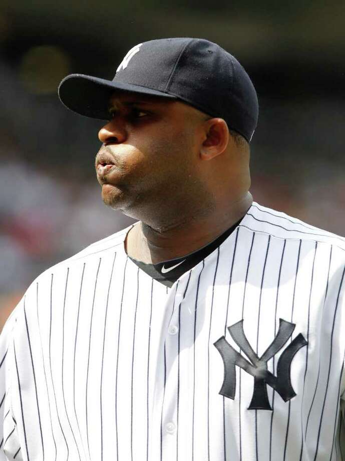 New York Yankees' CC Sabathia reacts as he leaves the field after the top of the eighth inning of a baseball game against the Colorado Rockies Saturday, June 25, 2011, at Yankee Stadium in New York. (AP Photo/Frank Franklin II) Photo: Frank Franklin II