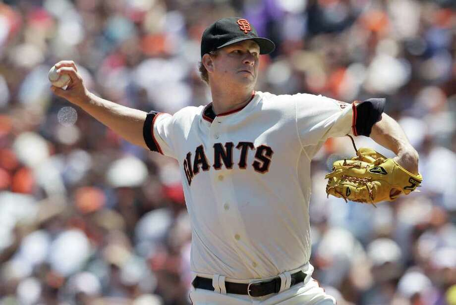 San Francisco Giants pitcher Matt Cain works against the Cleveland Indians in the third inning of an interleague baseball game in San Francisco, Saturday, June 25, 2011. (AP Photo/Jeff Chiu) Photo: Jeff Chiu