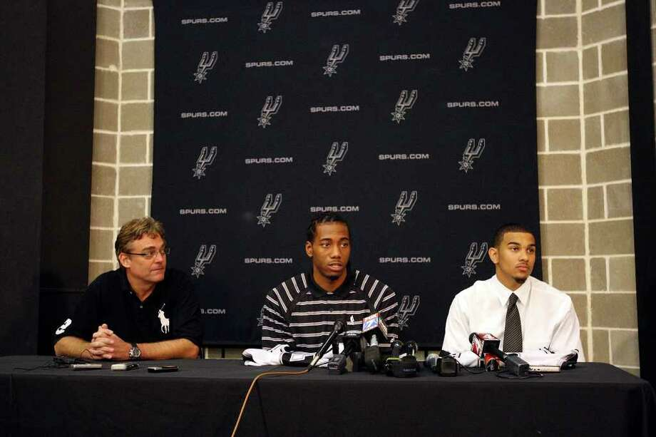 Spurs general manager R.C. Buford (from left) listens to players Kawhi Leonard and Cory Joseph answer questions during a press conference Saturday June 25, 2011 at the Spurs practice facility. EDWARD A. ORNELAS/eaornelas@express-news.net Photo: EDWARD A. ORNELAS, Express-News / © SAN ANTONIO EXPRESS-NEWS (NFS)