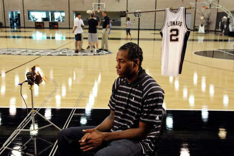 Spurs' Kawhi Leonard answers questions from the media Saturday June 25, 2011 at the Spurs practice facility. EDWARD A. ORNELAS/eaornelas@express-news.net Photo: EDWARD A. ORNELAS, Express-News / © SAN ANTONIO EXPRESS-NEWS (NFS)