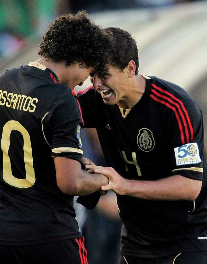 Mexico's Giovani Dos Santos, left, celebrates his goal with Javier Hernandez during the second half of the CONCACAF Gold Cup soccer final against United States, Saturday, June 25, 2011, in Pasadena, Calif. Mexico won 4-2. (AP Photo/Mark J. Terrill) Photo: Associated Press