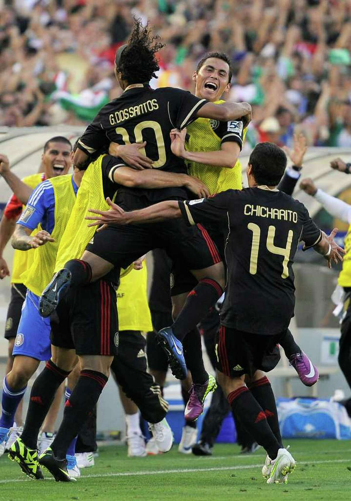 Mexico's Giovani Dos Santos (10) celebrates his goal with teammates during the second half of the CONCACAF Gold Cup soccer final against United States, Saturday, June 25, 2011, in Pasadena, Calif. Mexico won 4-2. (AP Photo/Mark J. Terrill)