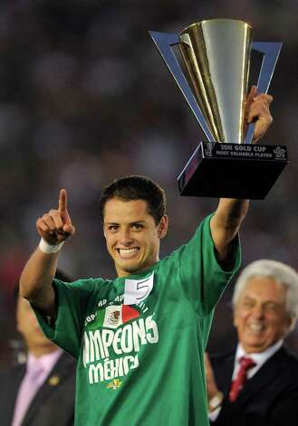 Mexico's Javier Hernandez holds up his Most Valuable Player trophy after Mexico defeated United States 4-2 in the CONCACAF Gold Cup soccer final, Saturday, June 25, 2011, in Pasadena, Calif. (AP Photo/Mark J. Terrill) Photo: Associated Press
