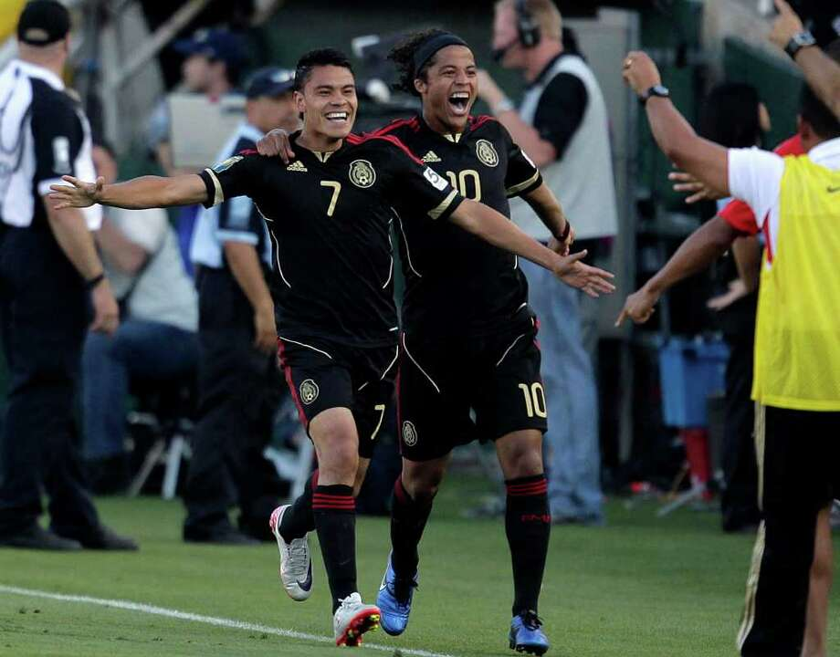 Mexico's Pablo Barrera, left, and Giovani Dos Santos celebrate after Barrera scored against United States during the second half of the CONCACAF Gold Cup soccer final game at the Rose Bowl in Pasadena, Calif., Saturday, June 25, 2011. (AP Photo/Jae C. Hong) Photo: Associated Press