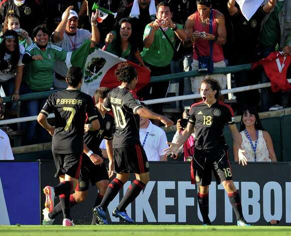 Mexico's Andres Guardado, right, celebrates his goal with teammates during the first half of the CONCACAF Gold Cup soccer final match against United States, Saturday, June 25, 2011, in Pasadena, Calif. (AP Photo/Mark J. Terrill) Photo: Associated Press