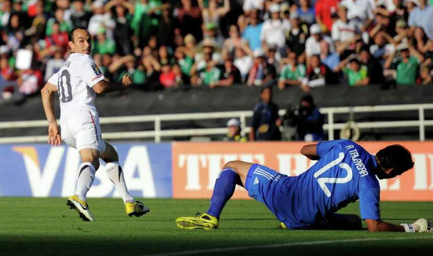 United States' Landon Donovan, left, looks back after scoring a goal on Mexico goalkeeper Alfredo Talavera during the first half of the CONCACAF Gold Cup soccer final, Saturday, June 25, 2011, in Pasadena, Calif. (AP Photo/Mark J. Terrill)