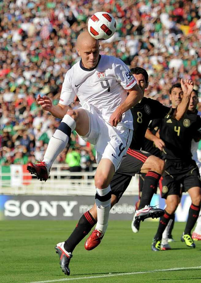 United States' Michael Bradley heads the ball in for a goal as Mexico's Israel Castro (8) defends during the first half of the CONCACAF Gold Cup soccer final against Mexico, Saturday, June 25, 2011, in Pasadena, Calif. (AP Photo/Mark J. Terrill) Photo: Associated Press