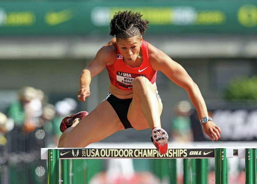 Hyleas Fountain clears a hurdle in the 100 meter hurdles in the heptathlon during the 2011 USA Outdoor Track & Field Championships at Hayward Field in Eugene, Ore., on Saturday, June 25, 2011.