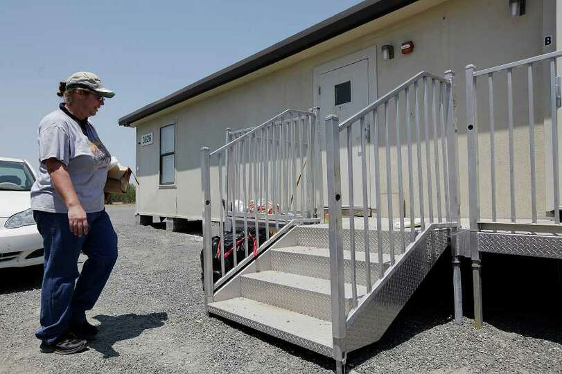 Angela Dukes arrives to clean a Signor Group's modular sleeping quarter on land outside Carrizo S