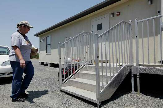 Angela Dukes arrives to clean a Signor Group's modular sleeping quarter on land outside Carrizo Springs, Texas, Thursday, June 9, 2011. Dukes moved to the area from Oklahoma and bided for the job. JERRY LARA/glara@express-news.net Photo: JERRY LARA, Jerry Lara/Express-News / SAN ANTONIO EXPRESS-NEWS