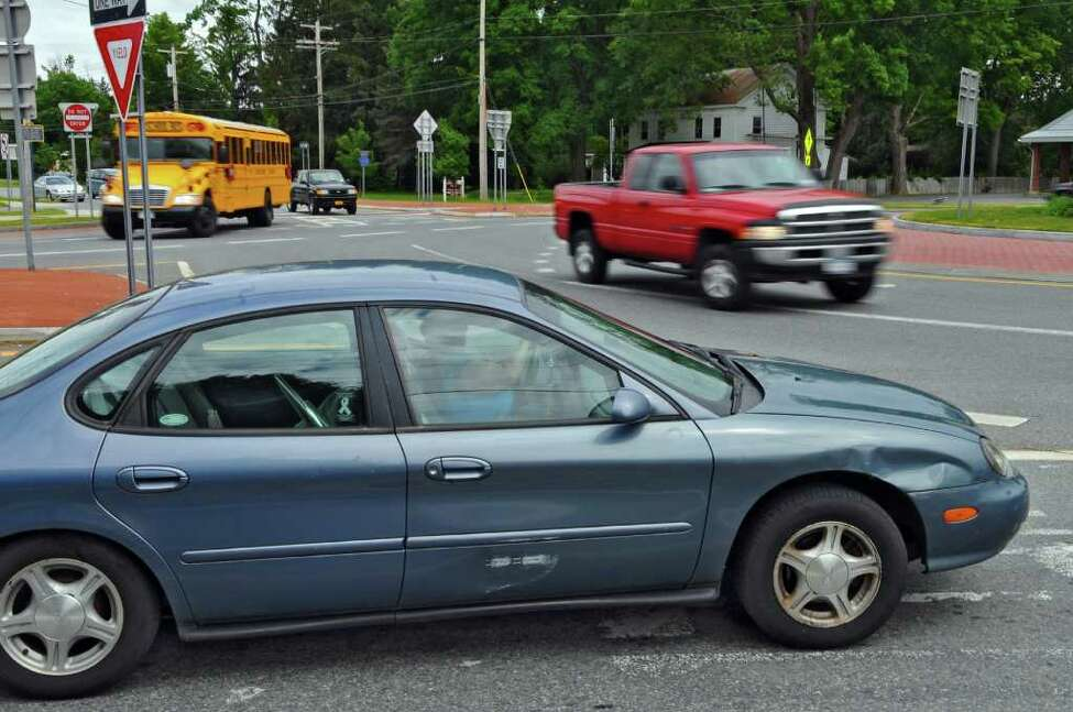 Traffic waits to merge onto the traffic circle at the intersection of Routes 9 and Dunning Street, upper left, on Tuesday June 14, 2011 in Malta, NY. ( Philip Kamrass / Times Union)