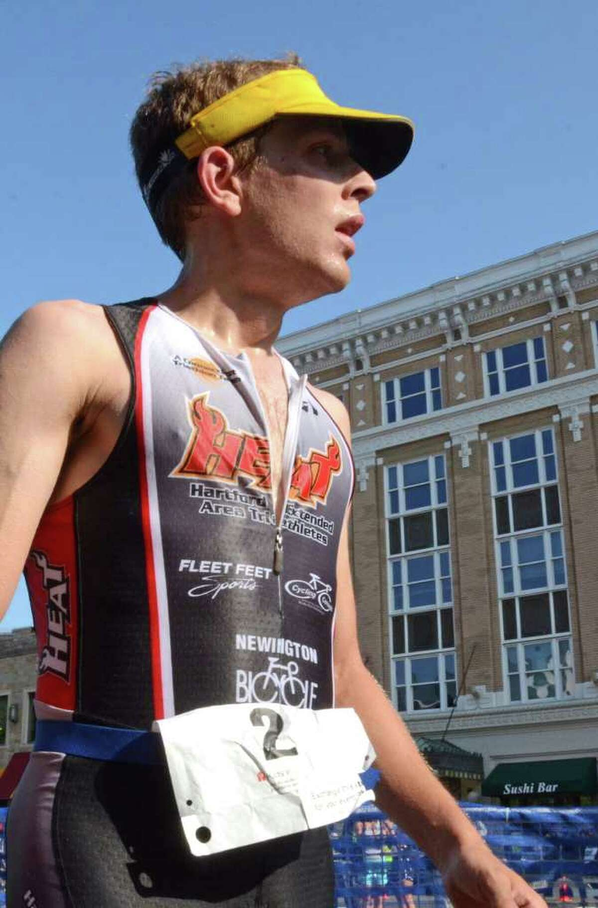 First place finisher Thomas McWalters, of Hartford, during the Stamford KIC IT Triathlon in Columbus Park Sunday June 27, 2010. The race features a mile swim off of Cummings Beach followed by a 24.8 mile bike throughout the city and a 6 mile run finishing at Columbus Park. The event drew more than 500 athletes raising money for Greenwich based Kids in Crisis.