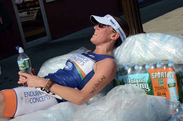 First place female finisher Brigitte Paulick, of New York, cools down on a bed of ice after the race during the Stamford KIC IT Triathlon in Columbus Park Sunday June 27, 2010. The race features a mile swim off of Cummings Beach followed by a 24.8 mile bike throughout the city and a 6 mile run finishing at Columbus Park. The event drew more than 500 athletes raising money for Greenwich based Kids in Crisis. Photo: Amy Mortensen / Connecticut Post Freelance