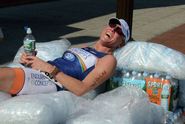 First place female finisher Brigitte Paulick, of New York, cools off on a bed of ice post race during the Stamford KIC IT Triathlon in Columbus Park Sunday June 27, 2010. The race features a mile swim off of Cummings Beach followed by a 24.8 mile bike throughout the city and a 6 mile run finishing at Columbus Park. The event drew more than 500 athletes raising money for Greenwich based Kids in Crisis. Photo: Amy Mortensen / Connecticut Post Freelance
