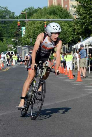 Thomas McWalters, of Hartford, competes in the Stamford KIC IT Triathlon in Columbus Park Sunday June 27, 2010. The race features a mile swim off of Cummings Beach followed by a 24.8 mile bike throughout the city and a 6 mile run finishing at Columbus Park. The event drew more than 500 athletes raising money for Greenwich based Kids in Crisis. Photo: Amy Mortensen / Connecticut Post Freelance