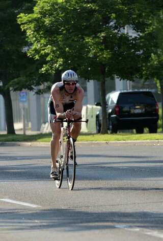 Mitch West, of Wilton, competes in the Stamford KIC IT Triathlon in Columbus Park Sunday June 27, 2010. The race features a mile swim off of Cummings Beach followed by a 24.8 mile bike throughout the city and a 6 mile run finishing at Columbus Park. The event drew more than 500 athletes raising money for Greenwich based Kids in Crisis. Photo: Amy Mortensen / Connecticut Post Freelance