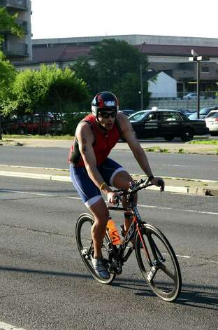 Chris Deubert, of New York, competes in the Stamford KIC IT Triathlon in Columbus Park Sunday June 27, 2010. The race features a mile swim off of Cummings Beach followed by a 24.8 mile bike throughout the city and a 6 mile run finishing at Columbus Park. The event drew more than 500 athletes raising money for Greenwich based Kids in Crisis. Photo: Amy Mortensen / Connecticut Post Freelance