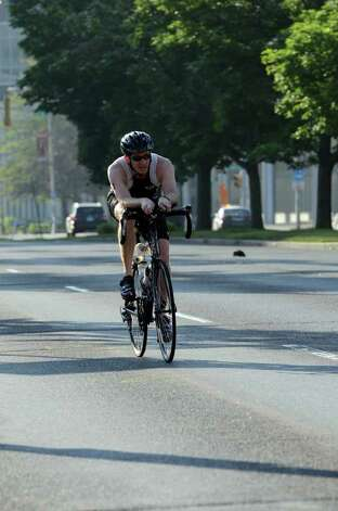Ryan Toner, of Bridgewater, NJ, competes in the Stamford KIC IT Triathlon in Columbus Park Sunday June 27, 2010. The race features a mile swim off of Cummings Beach followed by a 24.8 mile bike throughout the city and a 6 mile run finishing at Columbus Park. The event drew more than 500 athletes raising money for Greenwich based Kids in Crisis. Photo: Amy Mortensen / Connecticut Post Freelance