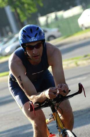 Cary Stathopoulos, of New York, competes in the Stamford KIC IT Triathlon in Columbus Park Sunday June 27, 2010. The race features a mile swim off of Cummings Beach followed by a 24.8 mile bike throughout the city and a 6 mile run finishing at Columbus Park. The event drew more than 500 athletes raising money for Greenwich based Kids in Crisis. Photo: Amy Mortensen / Connecticut Post Freelance