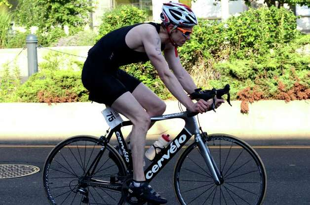 Parker Hayden, of New York, competes in the Stamford KIC IT Triathlon in Columbus Park Sunday June 27, 2010. The race features a mile swim off of Cummings Beach followed by a 24.8 mile bike throughout the city and a 6 mile run finishing at Columbus Park. The event drew more than 500 athletes raising money for Greenwich based Kids in Crisis. Photo: Amy Mortensen / Connecticut Post Freelance
