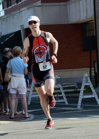 Guido Zgraggen, of Stamford, competes in the Stamford KIC IT Triathlon in Columbus Park Sunday June 27, 2010. The race features a mile swim off of Cummings Beach followed by a 24.8 mile bike throughout the city and a 6 mile run finishing at Columbus Park. The event drew more than 500 athletes raising money for Greenwich based Kids in Crisis. Photo: Amy Mortensen / Connecticut Post Freelance